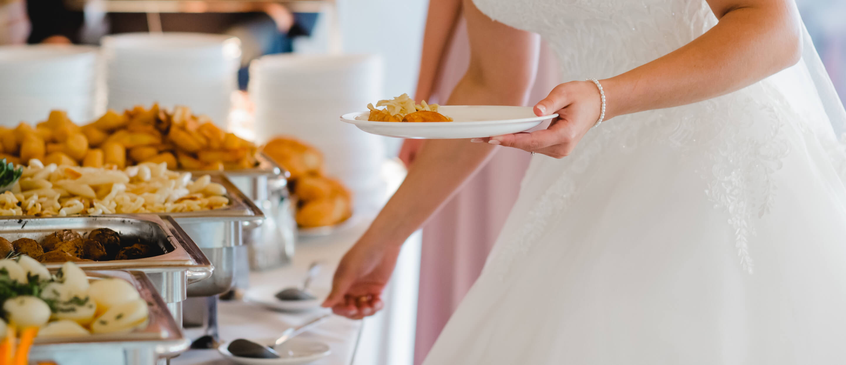 Bride making plate with catered food