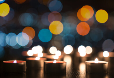 Candles with blurred lights in the background