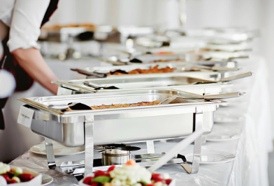 Catering pans of food lined up on table