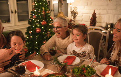 Family gathered around a table during Christmas