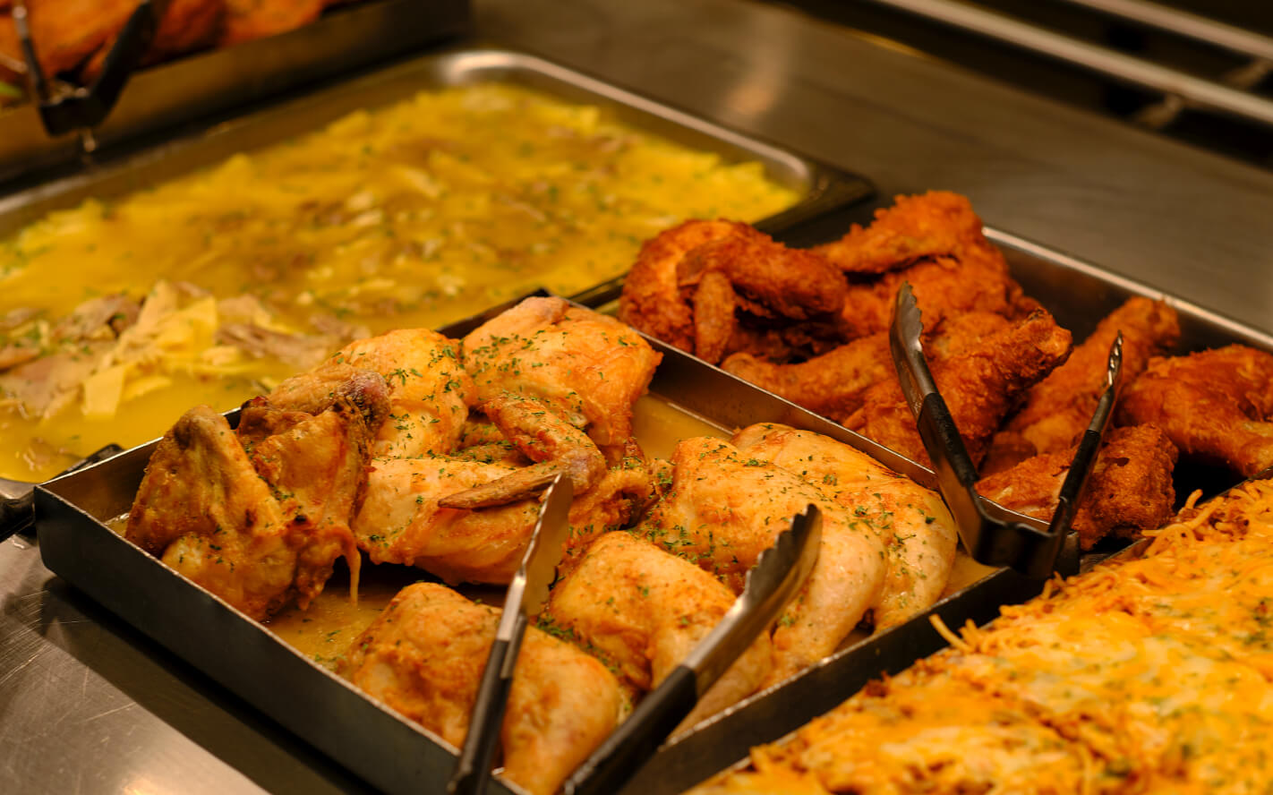 baked chicken, fried chicken, spaghetti and soup on food line