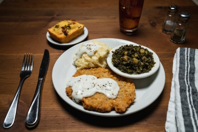 chicken fried steak with gravy, mashed potatoes and turnips