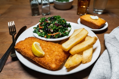 cod square with fries and a kale salad