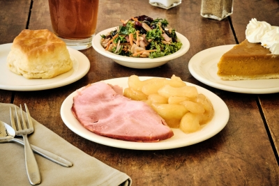 baked ham with baked apples and a salad