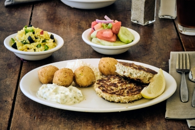 crab cakes with cucumber salad and hush puppies