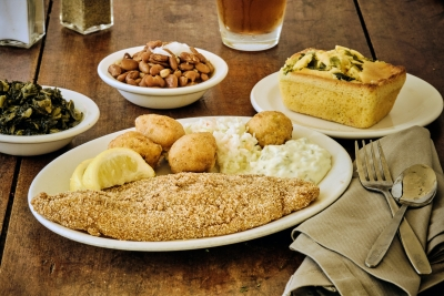 fried catfish with mashed potatoes, hush puppies, beans and turnips