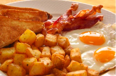 breakfast with potatoes, toast, bacon and eggs
