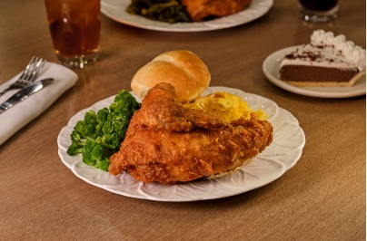 fried chicken with broccoli and a roll