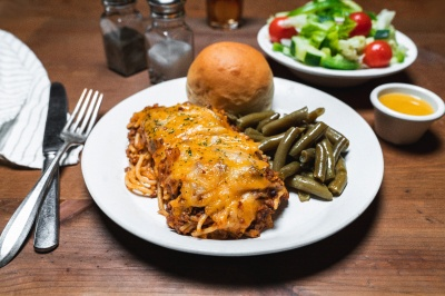baked spaghetti with green beans and a roll